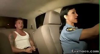 Female police officer fucks suspect in car