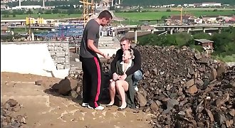 Public fuck of a slurps blonde girl by 2 guys at a construction site